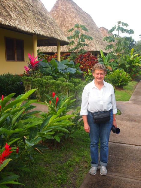 Lucy in front of our thatched cabin at Casa del Blanco Caballo