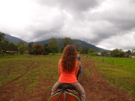 Returning to the coral, Clair from Nashville ahead, base of Arenal volcano shrouded in clouds