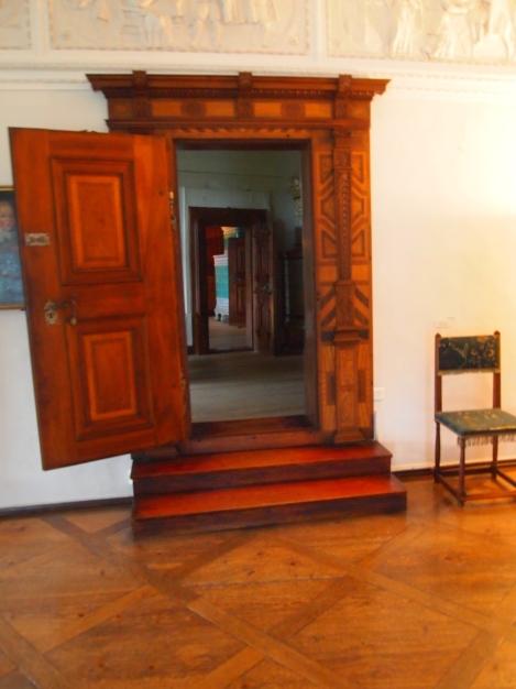Beautiful wood doors between large rooms