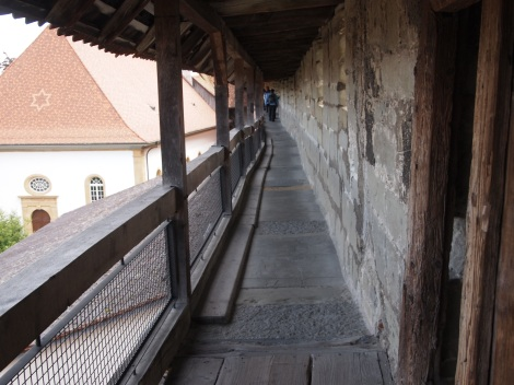 Narrow wooden walkway along Murten ramparts