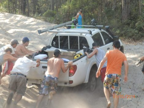 Pesky smaller 4WD bogged in the sand