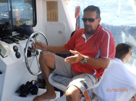 Skipper Joseph at the helm